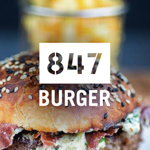 847 burger: Angus beef burger with hand sliced brisket, melted cheddar, fried pickle & BBQ sauce